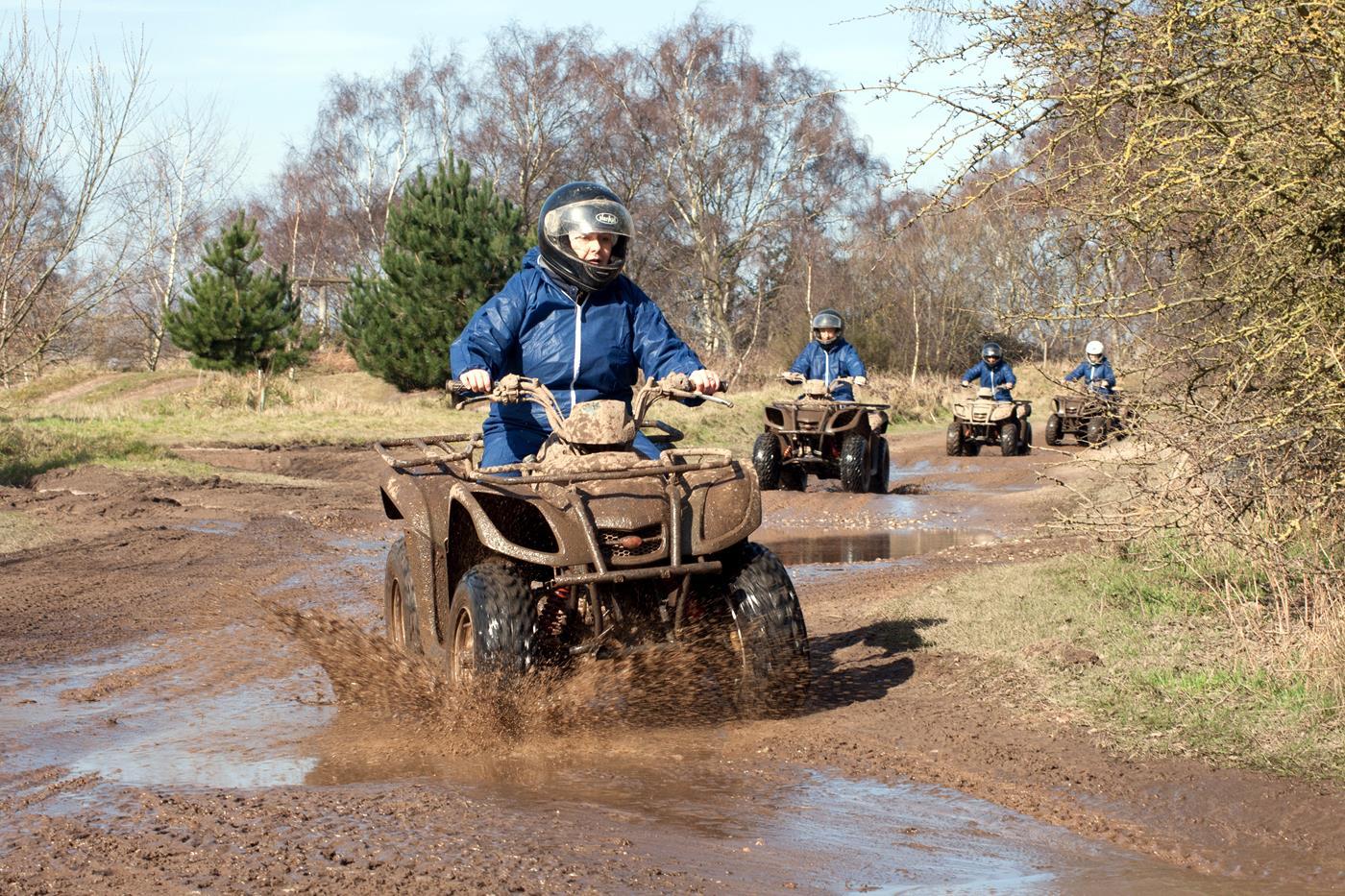 quad biking through mud